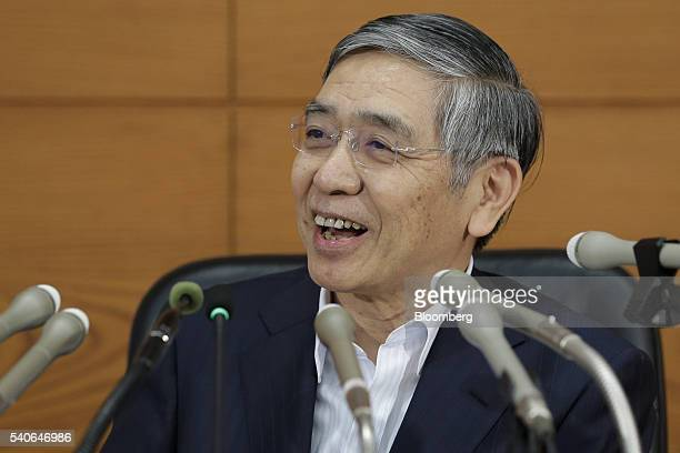Haruhiko Kuroda governor of the Bank of Japan smiles during a news conference at the central bank's headquarters in Tokyo Japan on Thursday June 16...