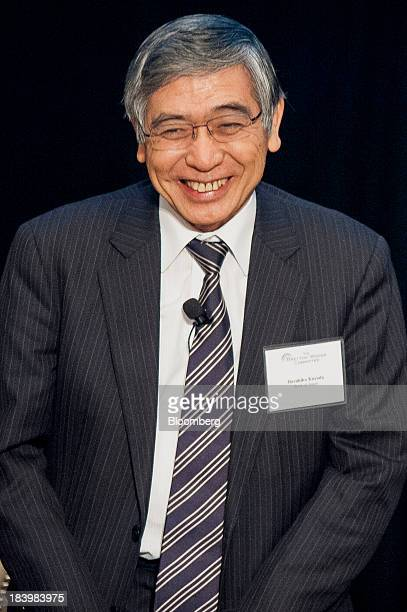 Haruhiko Kuroda governor of the Bank of Japan smiles during the 2013 Bretton Woods Committee International Council Meeting in Washington DC US on...
