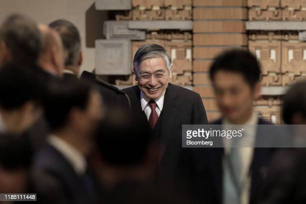 Haruhiko Kuroda, governor of the Bank of Japan , smiles while leaving the stage after speaking at the Paris Europlace International Financial Forum...