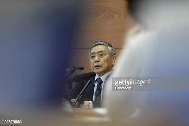 Haruhiko Kuroda, governor of the Bank of Japan , speaks during a news conference at the central bank's headquarters in Tokyo, Japan, on Monday, March...