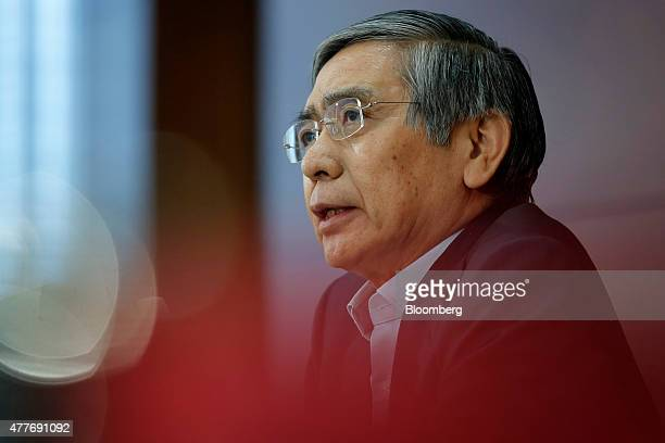 Haruhiko Kuroda governor of the Bank of Japan speaks during a news conference at the central bank's headquarters in Tokyo Japan on Friday June 19...