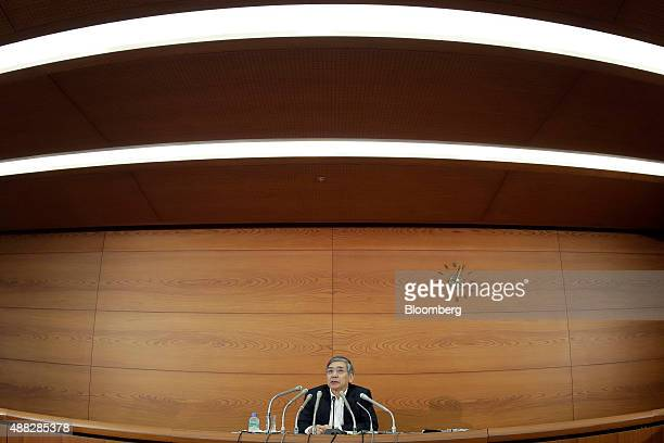 Haruhiko Kuroda governor of the Bank of Japan speaks during a news conference in this photograph taken with a fisheye lens at the central bank's...