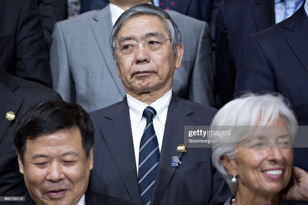 Haruhiko Kuroda, governor of the Bank of Japan (BOJ), stands during a Group of 20 (G-20) finance ministers and central bank governors group photo on the sidelines of the International Monetary Fund (IMF) and World Bank Group Annual Meetings in Washington, D.C., U.S., on Thursday, Oct. 12, 2017. Near-term risks to world financial stability have declined since April amid improving macroeconomic conditions and the subsiding risk of emerging-market turmoil, the IMF said in its latest Global Financial Stability Report released yesterday. Photographer: Andrew Harrer/Bloomberg via Getty Images