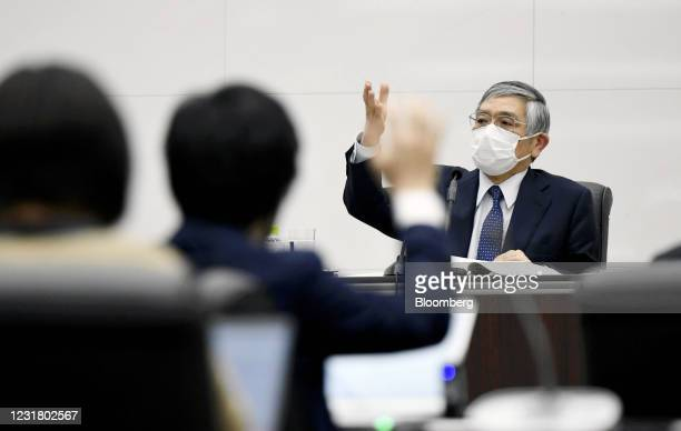 Haruhiko Kuroda, governor of the Bank of Japan , takes a question from member of the medias during a news conference at the central bank's...