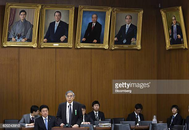 Haruhiko Kuroda governor of the Bank of Japan third left speaks during an appearance before the Committee on Financial Affairs in the lower house of...