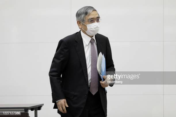 Haruhiko Kuroda governor of the Bank of Japan wearing a protective mask leaves a news conference at the central bank's headquarters in Tokyo Japan on...