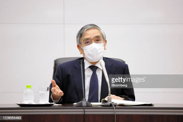 Haruhiko Kuroda, governor of the Bank of Japan , wearing a protective face mask, he speaks during a news conference at the central bank's...