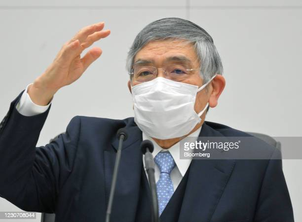 Haruhiko Kuroda, governor of the Bank of Japan , wears a protective mask as he speaks during a news conference at the central bank's headquarters in...