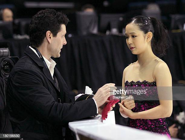 Haruka Imai of Japan speaks with coach Jason Dungjen before performing in Ladies Free Skating during Hilton HHonors Skate America at Citizens...