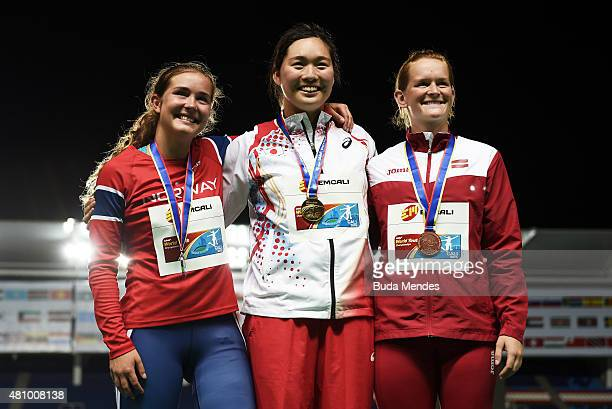 Haruka Kitaguchi of Japan, gold medal, Stella Weinberg or Norway, silver medal, and Laine Donane of Latvia, bronze medal, celebrate on the podium...