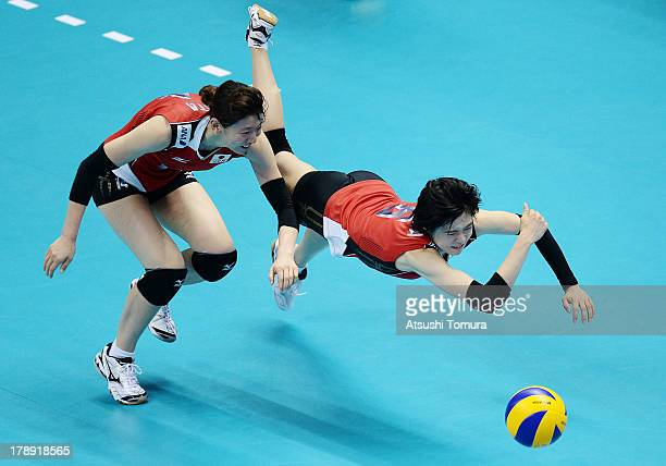 Haruka Miyashita and Yukiko Ebata of Japan dive for the ball during day four of the FIVB World Grand Prix Sapporo 2013 match between Japan and China...