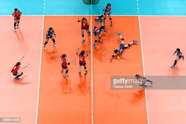 Haruka Miyashita of Japan dives for a hit against Korea during the Women's Preliminary Pool A match between Japan and Korea on Day 1 of the Rio de...