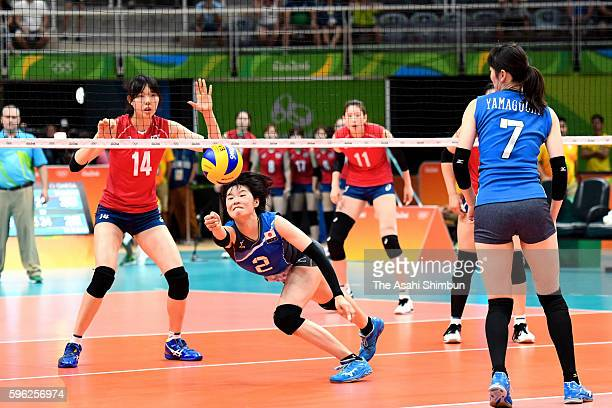 Haruka Miyashita of Japan dives for the ball during the Women's Preliminary Pool A match between Japan and Korea on Day 1 of the Rio de Janeiro...