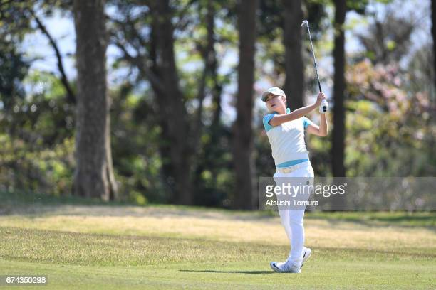 Haruka Morita of Japan hits her second shot on the 13th hole during the first round of the CyberAgent Ladies Golf Tournament at the Grand Fields...