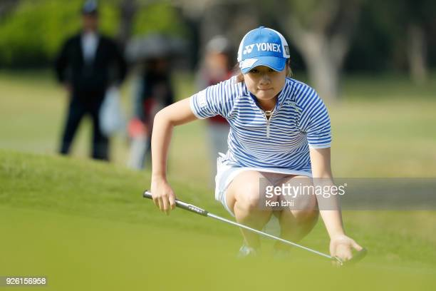 Haruka Morita of Japan lines up for her putt shot on the 9th green during the second round of the Daikin Orchid Ladies at Ryukyu Golf Club on March 2...