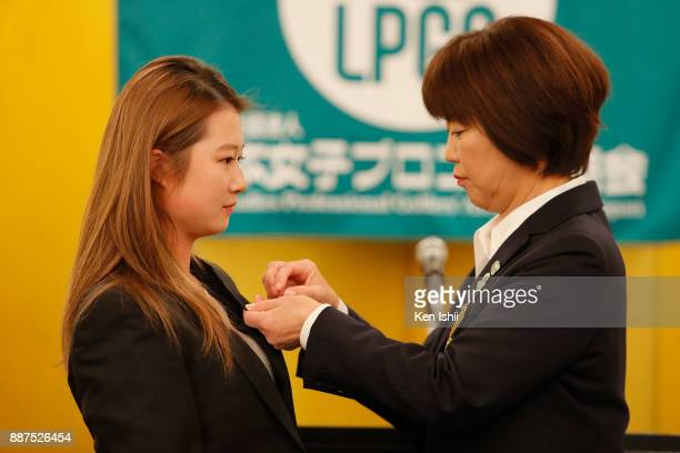 Haruka Morita of Japan receives a lapel pin from LPGA president Hiromi Kobayashi during the Ladies Professional Golfers' Association of Japan...