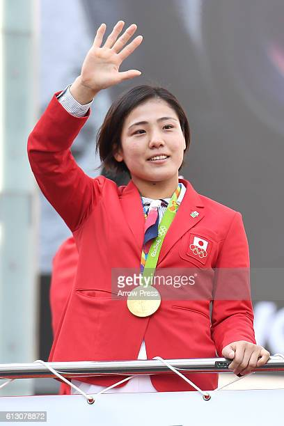 Haruka Tachimoto waves on the top of a double decker bus during the Rio Olympic Paralympic 2016 Japanese medalist parade in the ginza district on...
