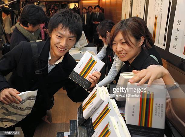 Haruki Murakami fans purchase his new book 'Colourless Tsukuru Tazaki and His Years of Pilgrimage' or...