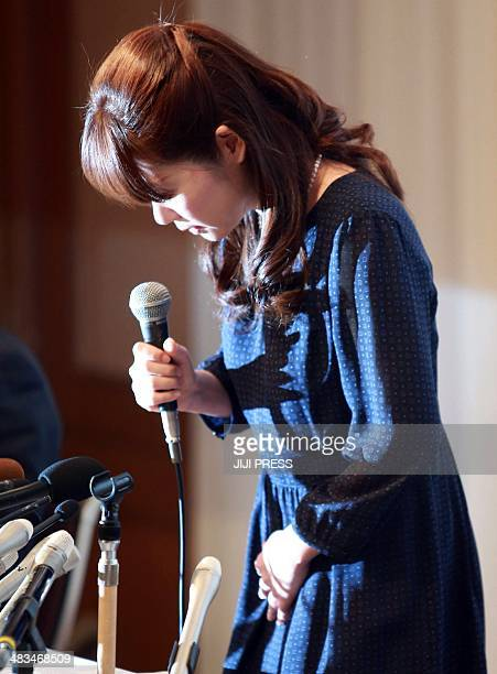 Haruko Obokata a female researcher of Japan's Riken Institute bows as she apologises at a press conference in Osaka, western Japan on April 9...