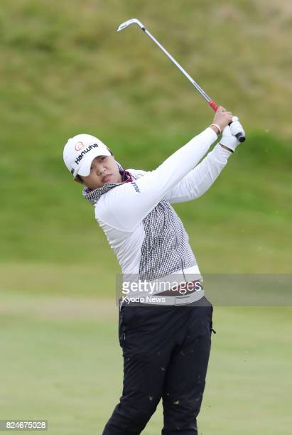 Harukyo Nomura of Japan hits her second shot on the first hole during the final round of the Ladies Scottish Open at Dundonald Links in Gailes...