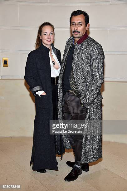 Harumi Klossowska de Rola and Haider Ackermann attend Chanel Collection des Metiers d'Art 2016/17 Paris Cosmopolite Show on December 6 2016 in Paris...