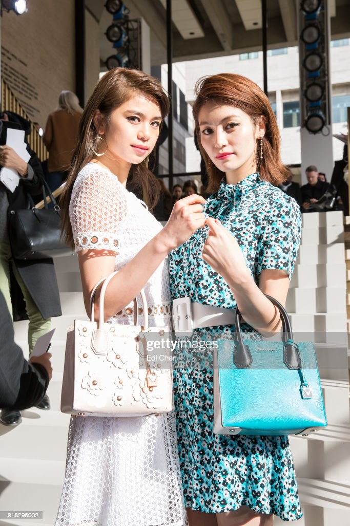 Harumi Sato & Kaede attend the Michael Kors Collection Fall 2018 Runway Show at the Vivian Beaumont Theatre on February 14, 2018 in New York City.