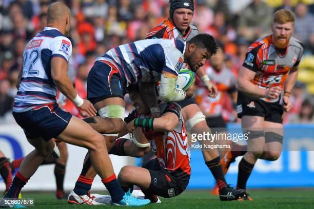 Harumichi Tatekawa of Sunwolvestackles againt Amanaki Mafi during the Super Rugby round 3 match between Sunwolves and Rebels at the Prince Chichibu...