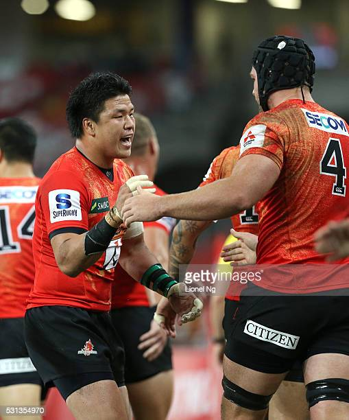 Harumichi Tatekawa of the Sunwolves celebrates with teammate Timothy Bond after Akihito Yamada scores a try during the round 12 Super Rugby match...