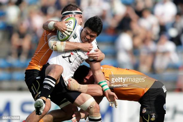 Harumichi Tatekawa of the Sunwolves is tackled by Niell Jordaan and Charles Marais of the Cheetahs during the Super Rugby Rd 14 match between...