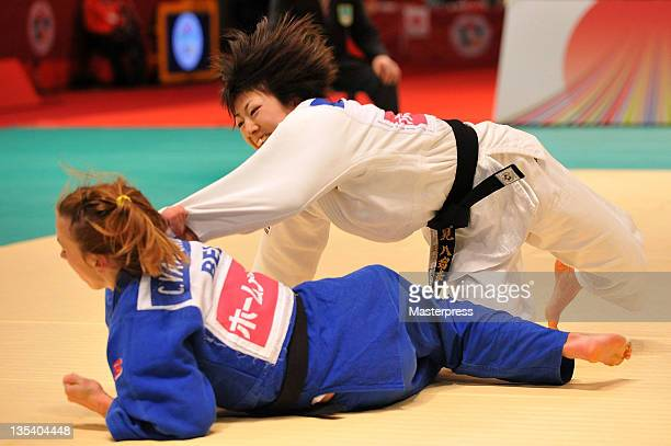 Haruna Asami and Charline van Snick of Belgium compete in the Women's 48kg Semi Final during day one of the Judo Grand Slam Tokyo at Tokyo...