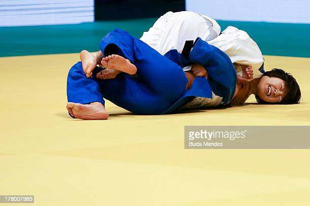 Haruna Asami of Japan fights against Charline Van Snick of Belgium, in the -48 kg category during the World Judo Championships at the Maracanazinho...