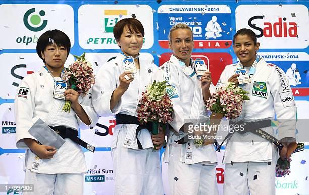 Haruna Asami of Japan, GOLD: Urantsetseg Munkhbat of Mongolia, BRONZE: Charline Van Snick of Belgium and Sarah Menezes of Brazil pose during the...