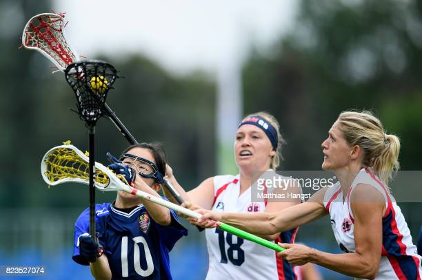 Haruna Kanetou of Japan is challenged by Sophie Morrill and Laura Warren of Great Britain during the Lacrosse Women's match between Great Britain and...