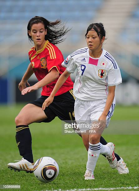 Haruna Kawashima of Japan is challenged by Paula Lopez of Spain during the FIFA U17 Women's World Cup Group C match between Spain and Japan at the...