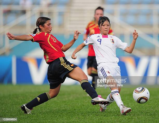 Haruna Kawashima of Japan is tackled by Marina Garcia of Spain during the FIFA U17 Women's World Cup Group C match between Spain and Japan at the Ato...