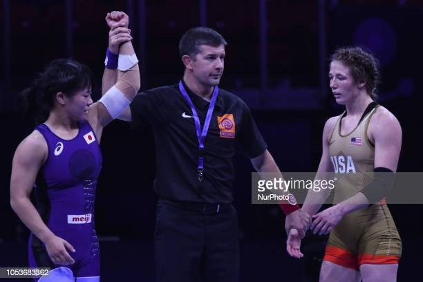 Haruna OKUNO of Japan wins against Sarah Ann HILDEBRANDT of USA a Gold medal fight in women's freestyle wrestling 53kg category at the World...