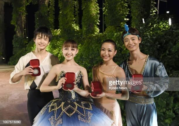 Haruto Goto Elena Iseki Miyu Takamori and Itsuki Omori show their Varna International Ballet Competition medals in Varna Bulgaria on July 30 2018...