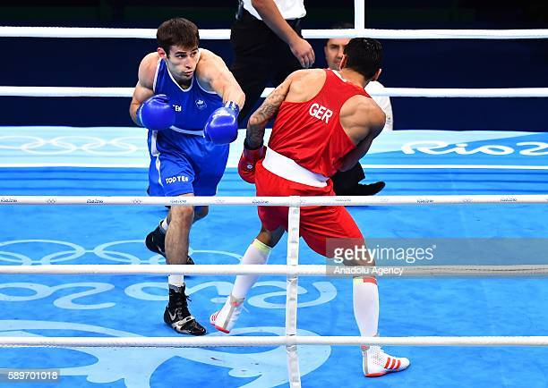 Harutyunyan Artem of Germany fights Arthur Biyarslanov of Canada during the Mens Light Welter 64KG Preliminaries on Day 9 of the Rio 2016 Olympic...