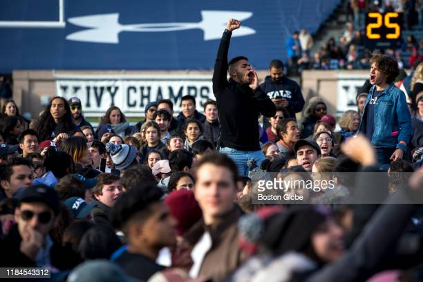 Harvard and Yale students protest during the halftime of the college football game between Harvard and Yale at the Yale Bowl in New Haven CT on...