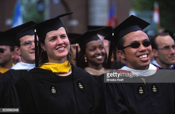 Harvard Business School students attend their graduation in Boston MA Harvard Business School is one of the graduate schools of Harvard University...