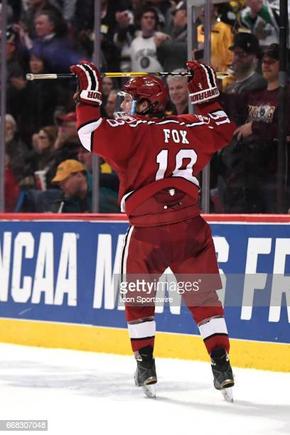 Harvard Crimson defenseman Adam Fox reacts after an NCAA Frozen Four semifinal game with the Harvard Crimson and the MinnesotaDuluth Bulldogs on...