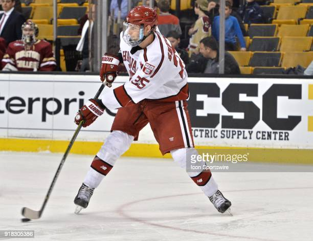 Harvard Crimson defenseman Wiley Sherman fires a rocket of a pass up ice During the Harvard University game against the Boston College Eagles at TD...