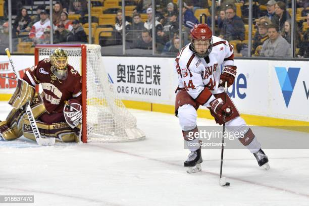 Harvard Crimson forward Michael Floodstrand gets control of the loose puck in the Boston College zone During the Harvard University Crimson game...