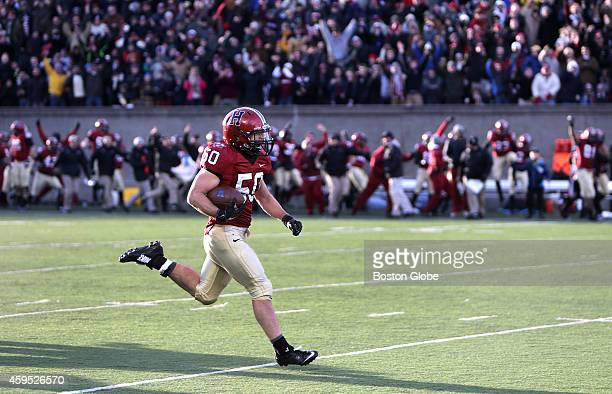 Harvard Crimson linebacker Connor Sheehan was free and clear as he runs back a pick 6 interception in the third quarter for 90 yards and a 247 lead...