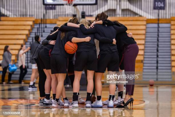 Harvard Crimson players huddle prior to the Ivy League college basketball game between the Harvard Crimson and Princeton Tigers on February 21 2020...