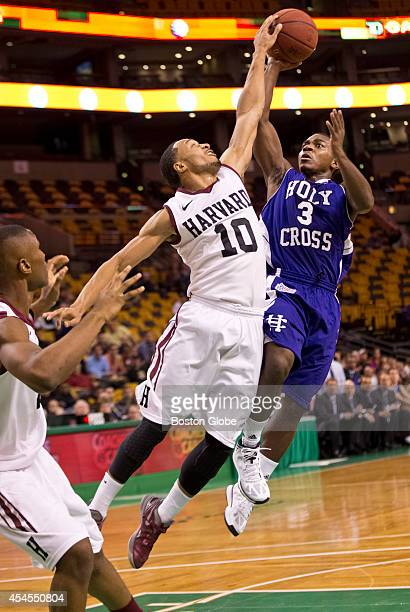 Harvard Crimson's Brandyn Curry blocks Holy Cross Crusaders Justin Burrell shot during first half action of the Coaches vs Cancer TippOff Tournament...