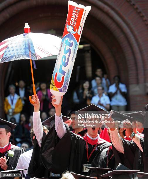 Harvard Dental School students show the need for proper dental care as they are conferred at the Harvard University Commencement in Harvard Yard....