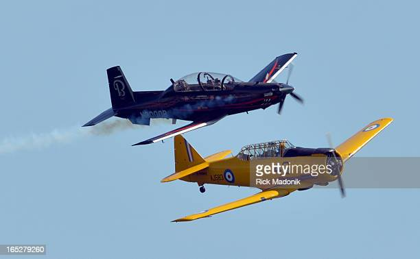 Harvard II and its predecessor Harvard fly a Heritage pass The 63rd annual Canadian International Air Show a featured act of the annual CNE took off...