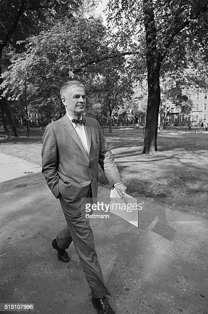 Harvard Law Professor Archibald Cox with notes in hand taking big strides as he crossed the Harvard yard to attend press conference 5/18 after being...