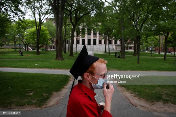 Harvard Law School graduate Jesse Burbank spends time on campus before attending the online graduation ceremony in his room in Cambridge, MA on May...